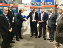 Hans Künz GmbH and Conductix-Wampfler have signed a contract for motor driven cable reels for 32 ASCs at the Conductix-Wampfler booth at TOC Europe in Amsterdam (from L to R: Johannes Moser, Head of Purchasing & Transport Logistics, Hans Künz GmbH; Christ